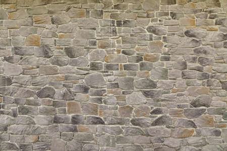 bumpy: Modern Textured Grey Yellow Stonewall Made From Flagstone And Sandstone Slabs Background, Bumpy Stone Wall Texture, Rocky Structure Backdrop Stock Photo