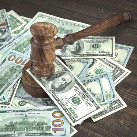 Auction Or Trial Concept With Auctioneers Or Judges Gavel And Scattered Money Heap On Wooden Table, Close Up,