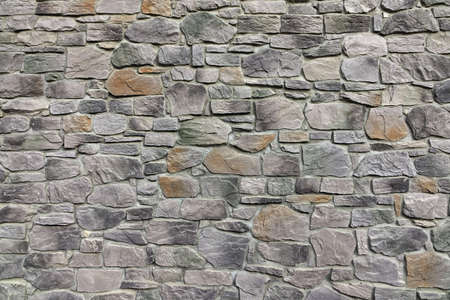 flagstone: Modern Textured Grey Yellow Stonewall Made From Flagstone And Sandstone Slabs Background, Bumpy Stone Wall Texture, Rocky Structure Backdrop Stock Photo