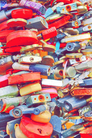 vows: Love Heart Locks. Colorful Padlocks Tree On Bridge Railing In A European City. The Tradition Of The Newlyweds. A Symbol Of The Vows Of Love And Fidelity Forever. Vertical Image Stock Photo