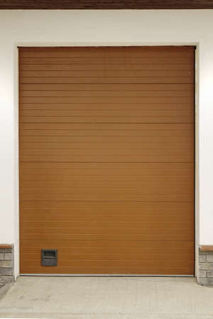 pushup: Automatic Electric Roll-up Commercial Garage Gate Or Push-up Door In The Modern Building Wall