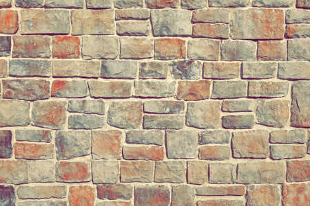 ledge: Modern Outdoor Building Stonewall Background Texture Decorated With Multicolored Split Face Natural Ledge Stone Tile In Medieval Style With Irregular And Chaotic Absrtact Mosaic Pattern, Close Up Stock Photo