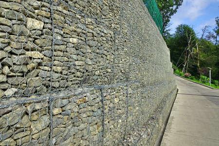 gabion: Concrete Driveway And Drains On The Hillside, Slope Reinforced Concrete Road, Summer Landscape