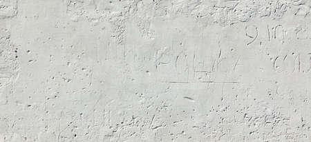 whitewash: Aged White Brick Wall Wide Texture.  Distressed Whitewash Brickwall Empty Background. Grunge Gray Dirty Stonewall Surface. Dark White Grey Shabby Exterior Worn Wreck Wall. Abstract Horizontal Banner Stock Photo