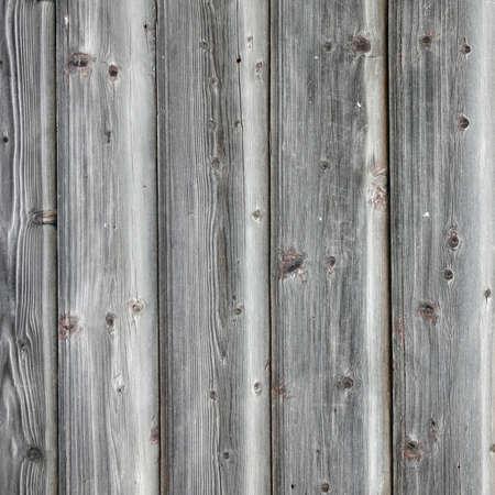 四角形のテクスチャの Planking 灰色納屋の木製壁。古い固体木製のスラット素朴なぼろぼろの灰色の背景。堅材ダークは、正方形の表面を風化。汚れ