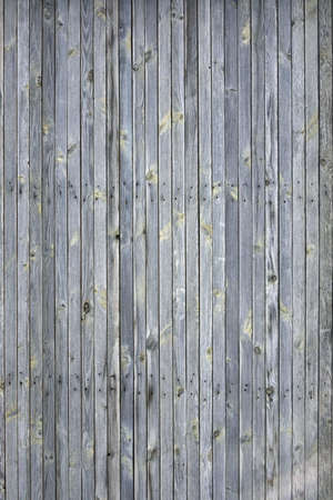 planking: Dingy Grey Barn Wooden Wall Planking Vertical Texture. Old Solid Wood Slats Rustic Shabby Gray Background. Hardwood Dark Weathered Vintage Surface. Grungy Faded Timber Wood Rough Exterior Structure. Stock Photo