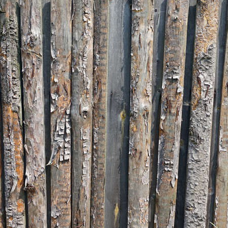 laths: Old Half Wood Square Background. Grey Wooden Frame Texture. Rustic Barn Wood Isolated Exterior Outdoor Rectangle Surface. Natural Rustic Vertical Logs With Bark Rectangular Structure