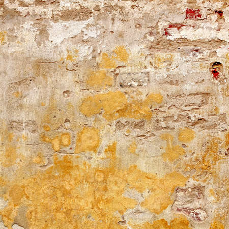 brickwall: Grungy Brickwall With Broken Stucco Frame Texture. Old Brick Wall With Damaged Shabby Yellow Plaster Square Background. Lime Wash Distressed Stonewall Rectangular Wallpaper. Chipped Rough Uneven Fence