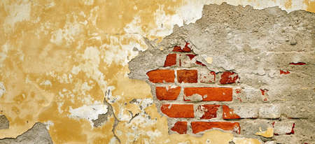 brickwall: Grunge Brickwall With Broken Stucco Texture. Old Brick Wall With Damaged Shabby Yellow Plaster Layer Background. Lime Wash Distressed Stonewall Wallpaper. Chipped Rough Stonewall Uneven Web Banner