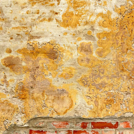 Grungy Brickwall With Broken Stucco Frame Texture. Old Brick Wall With Damaged Shabby Yellow Plaster Square Background. Lime Wash Distressed Stonewall Rectangular Wallpaper. Chipped Rough Uneven Fence