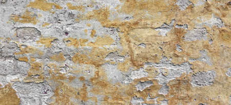 Dark Plaster Wall With Dirty Yellow Scratched Horizontal Background. Old Brickwall With Peel Swamp Color Stucco Texture. Retro Vintage Worn Wall Wallpaper. Decay Crack Rough Abstract Banner Surface. Reklamní fotografie