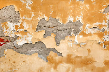 brickwall: Old Brick Wall With Damaged Shabby Yellow Plaster Layer Background. Grunge Brickwall With Rundown Stucco Horizontal Texture. Lime Wash Distressed Vintage Stonewall Wallpaper. Chipped Stonewall Surface Stock Photo
