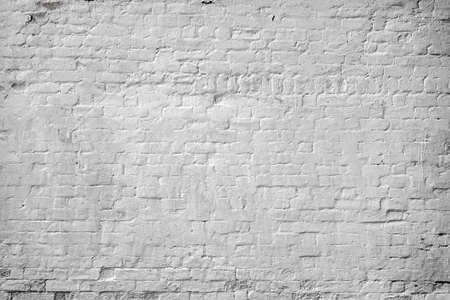 Vintage Brick Wall With White Damaged Plaster Horizontal Texture Or Background. Whitewashed Wall In The Interior Made Of The Old Clay Bricks