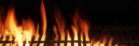 Barbecue Fire Grill Isolated On Black Background. BBQ Flaming Charcoal Grill Isolated. Hot Barbeque Charcoal Cast Iron Grill With Bright Flames Of Fire. Abstract Panoramic Grill Wide Banner. Standard-Bild