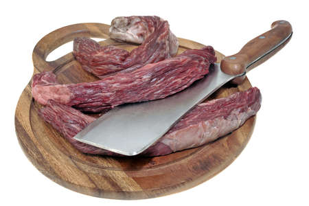 Raw Skirt Steak or Tenderloin Beef Steak and Butcher Hatchet on Cutting Board Isolated on White Background, Overhead View. Uncooked Machete Steak or Bavet Steak On White Background. 版權商用圖片