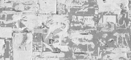 Grunge Wide Background with Old Torn Posters. Urban Graffiti Wall Texture. Grungy Ripped Wall with Torn Posters and Ads Background. Panoramic Urban Wallpaper. Graffiti Wall Texture. 版權商用圖片