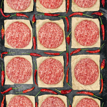 Many Raw Minced Steak Burgers from Beef Pork Meat on Black Background, Overhead View. Uncooked Ground Meat Patties for Grilling. Burgers for BBQ Grill and Grilling Tools, Top View. Abstract Pattern. 版權商用圖片
