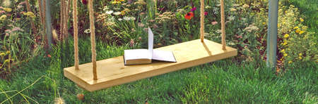 Wooden Swing in Garden with Open Book. Swing in Beautiful Summer Backyard Garden on Warm and Sunny Day Outdoors. Beautiful Garden Vintage Place for Family Rest In Shaded Garden. Romantic Garden Place. 版權商用圖片