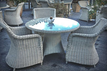 Alfresco Restaurant Surface With Wicker Furniture. Rattan Table And Armchair In Retro Cafe.