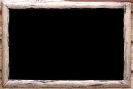 Closeup of Blank Menu Blackboard Hanging in Pub or Bar Interior On Grunge Wall. Mock up. Empty Chalkboard Menu Sign Mockup Isolated On Wood Wall Background. 版權商用圖片