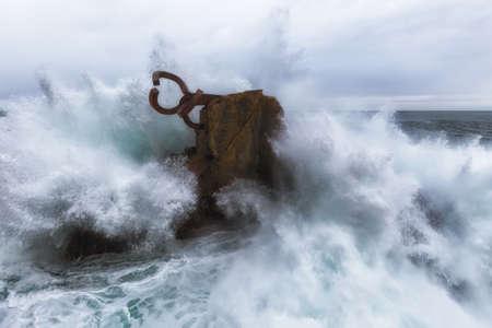 sited: Waves splashing in El peine de los vientos, Chillidas sculpture sited in Donostia, Spain, on March 2017