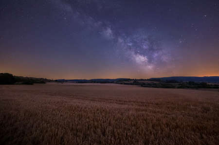 Milky Way over cereal fields in Onraita, Alava Reklamní fotografie