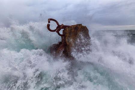 Waves splashing against El peine Del Viento in Donosti