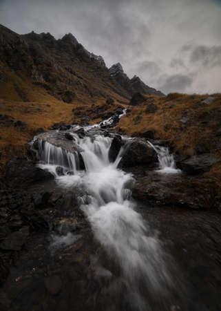 Icelandic waterfall, nordic waterfall in east fjords, Iceland