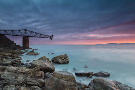 Sunrise at the Cantabric sea in Cantabria, color in the sky