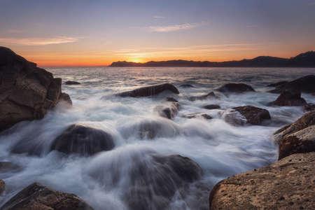 Water splash over the rocks in Bermeo, Spain Stockfoto