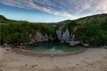 Secret and hidden Gulpiyuri beach in LLanes Asturias