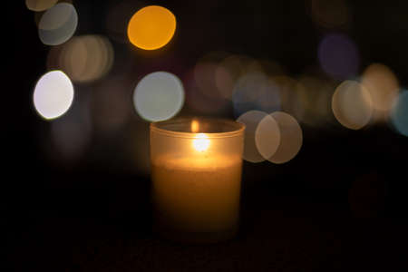 Candle alone with a great bokeh at night