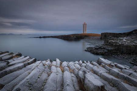 Basaltic columns in Kálfshamarsviti lighthouse in Iceland Imagens