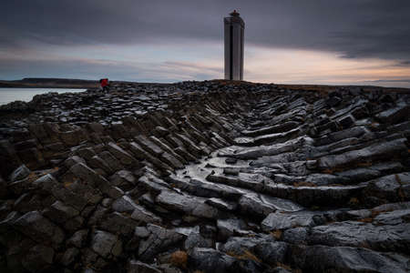 Basaltic columns in Kálfshamarsviti lighthouse in Iceland 版權商用圖片