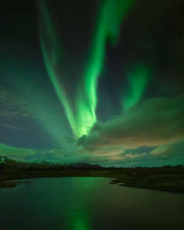 Northern lights over a lake in winter in Iceland