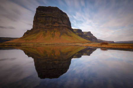 Lomagnupur, colossal rock reflected in a lake