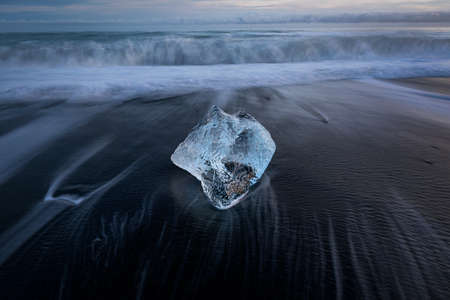 Diamond beach, ice blocks in a black sand beach  版權商用圖片