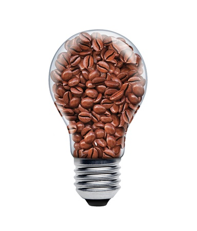 exhilarating: Coffee seeds in a light bulb Stock Photo