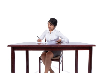 front desk: Attractive businesswoman writing notes at her desk