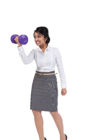 Angry Asian businesswoman holding a dumbbell photo