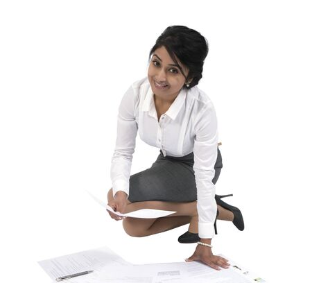 Portrait of a happy young Asian businesswoman  with documents photo