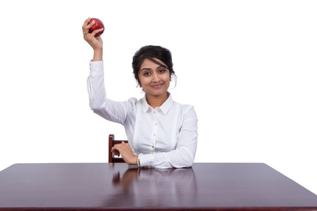 Attractive young businesswoman holding an apple photo