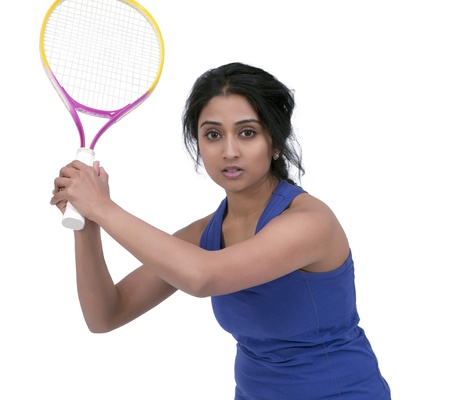 Female tennis player posing with tennis racket photo