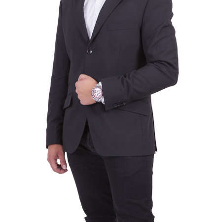 Mid section of a young businessman standing against white