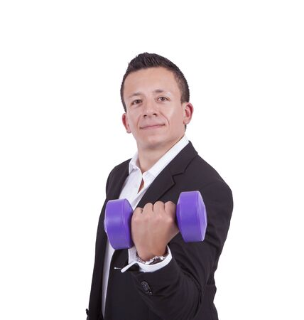 Portrait of a young mixed race businessman exercising with dumbbell