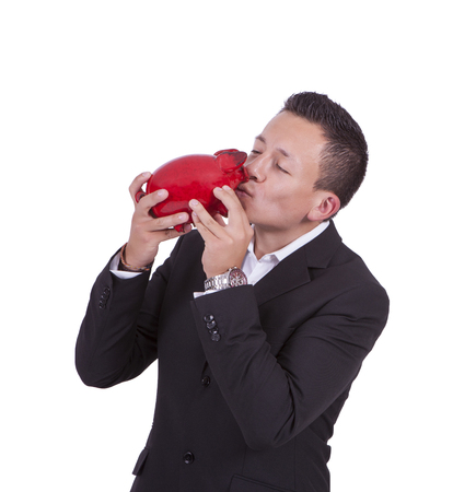 Businessman kissing his piggy bank photo