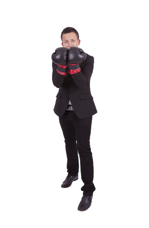 Handsome young businessman posing with boxing gloves Banco de Imagens