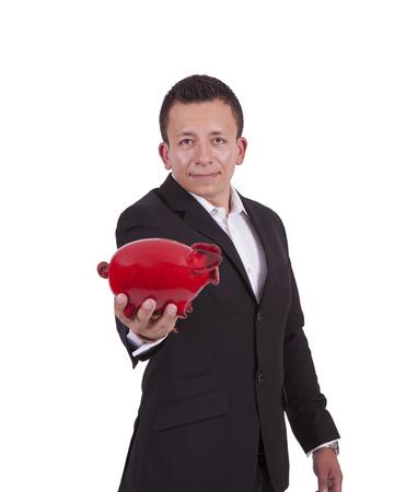 Portrait of a handsome young businessman posing with a piggy bank Banco de Imagens