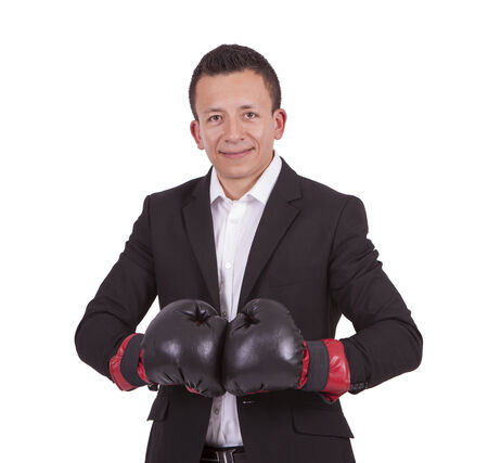 Portrait of a smiling young businessman with boxing gloves posing against white