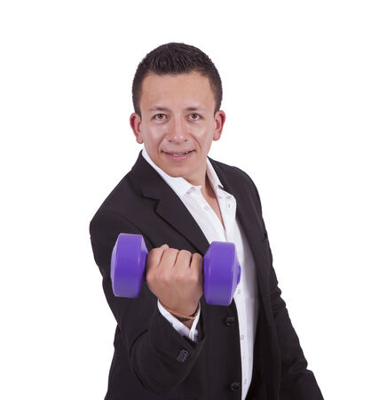 Portrait of a smiling young businessman exercising with dumbbell